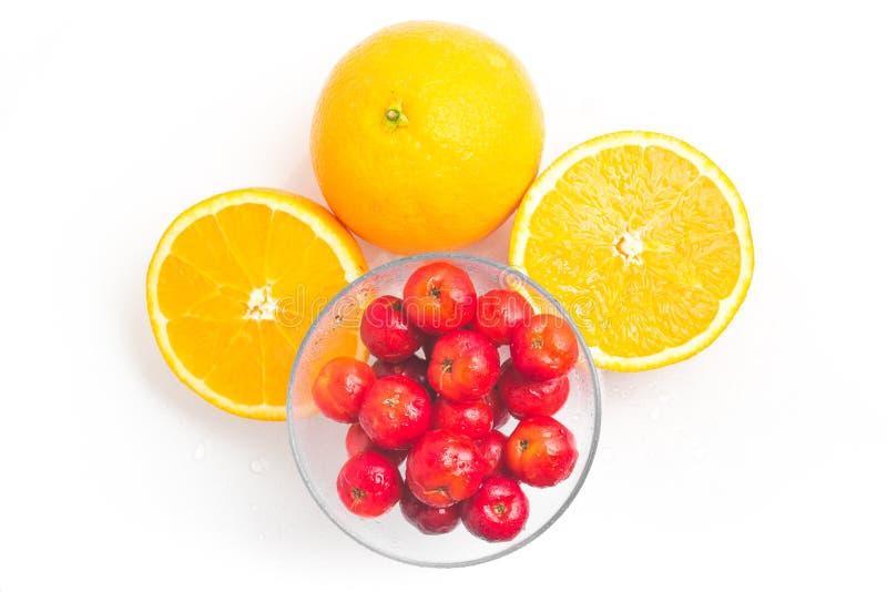 Cerise brésilienne d'Acerola et fruit orange photographie stock