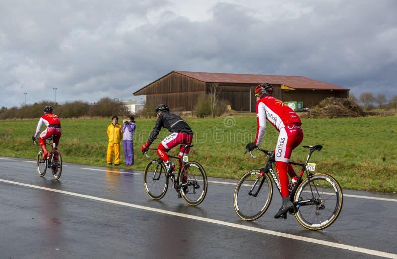 Three Cyclists - Paris-Nice 2017 royalty free stock image
