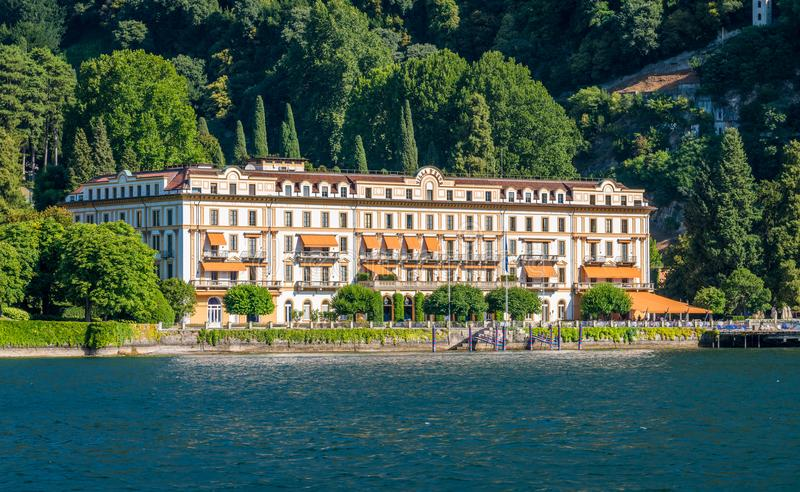 Villa d`Este on a sunny summer day, in Cernobbio, on Lake Como, Lombardy, Italy. Cernobbio is a small town located northwest of Como, home to some of the most royalty free stock photos