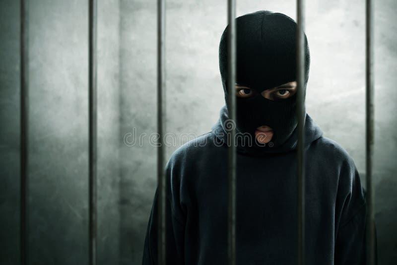 Cerradura enmascarada del ladrón en la prisión foto de archivo libre de regalías