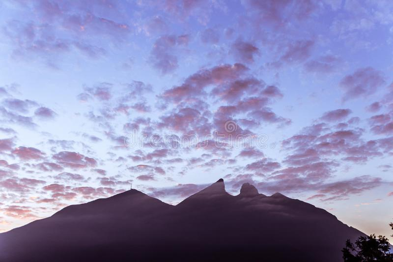 Famous mountain in Monterrey Mexico called Cerro de la Silla. Cerro de la Silla mountain silhouette in Monterrey Nuevo Leon Mexico stock image