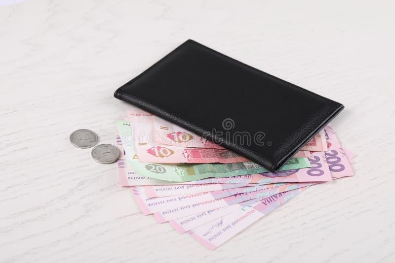 Certificado da pensão com dinheiro ucraniano no fundo branco imagens de stock royalty free