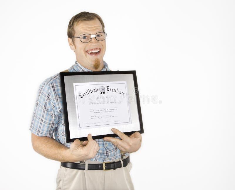 Certificat de fixation de jeune homme. image libre de droits
