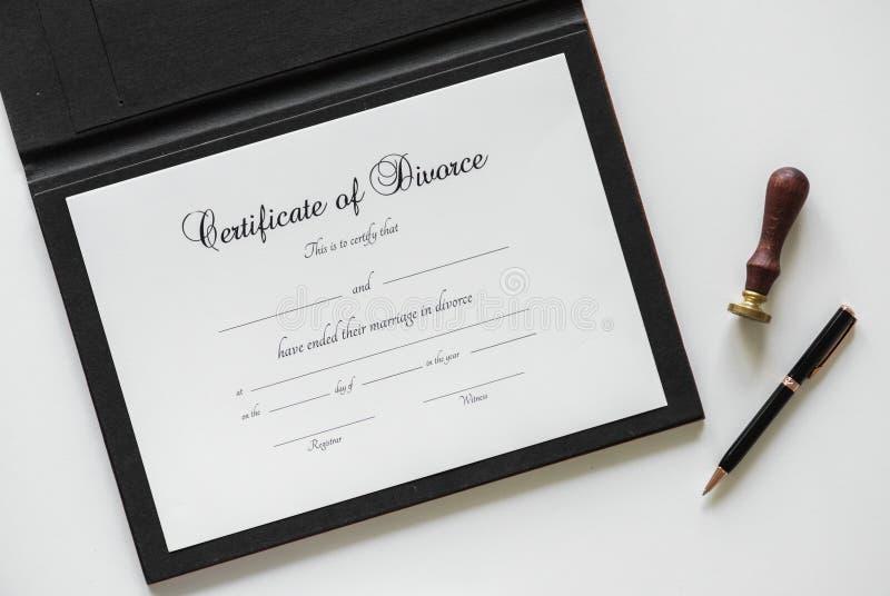 Certificate of Divorce Paper Beside Black Ballpoint Pen royalty free stock image