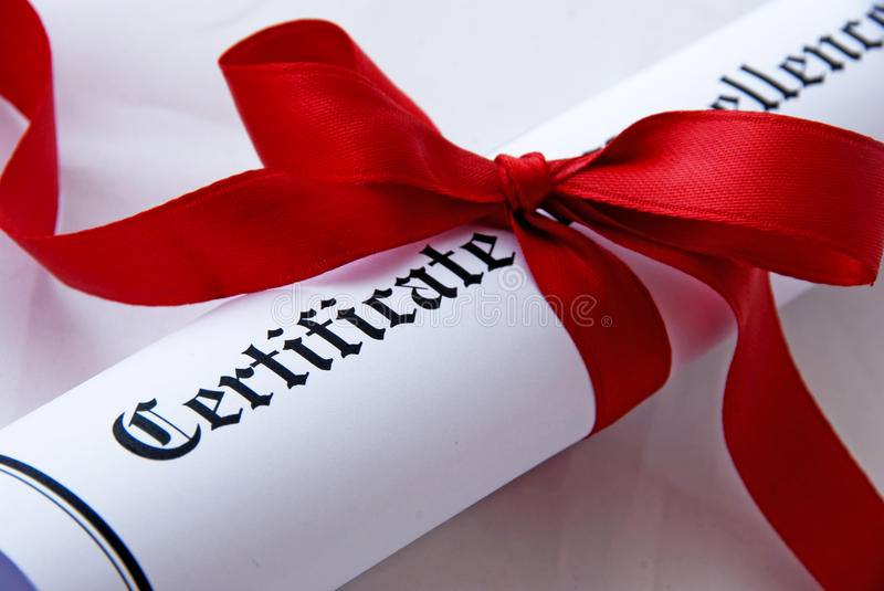 Certificate of excellence. With a red ribbon stock images