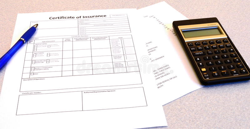 Certificate of Insurance. With pen, calculator and figures royalty free stock image