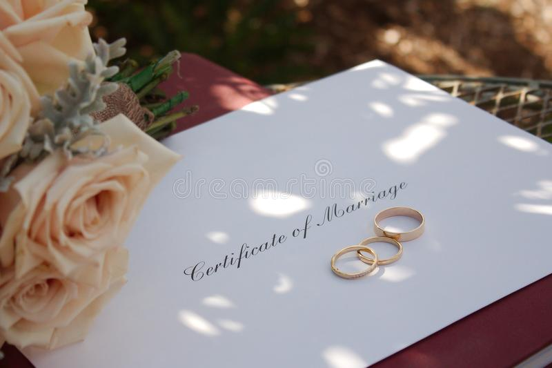 Certificate of Marriage, Rings & Bouquet royalty free stock images