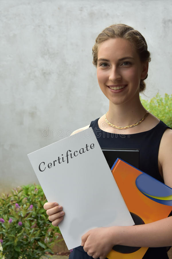 Certificate of qualification for university matriculation. School is finished Teenage girl with her certificate of qualification for university matriculation royalty free stock image
