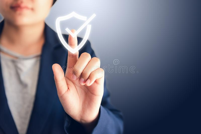 Certified Guarantee Approval or Secure Access System Concept, Business Woman is Pressing Identity Proofing Icon for Security. Protection Systems on Screen stock photography