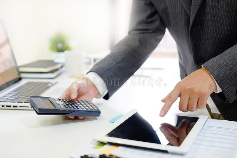 Certified public accountant, Man working on smartphone tablet co stock photos