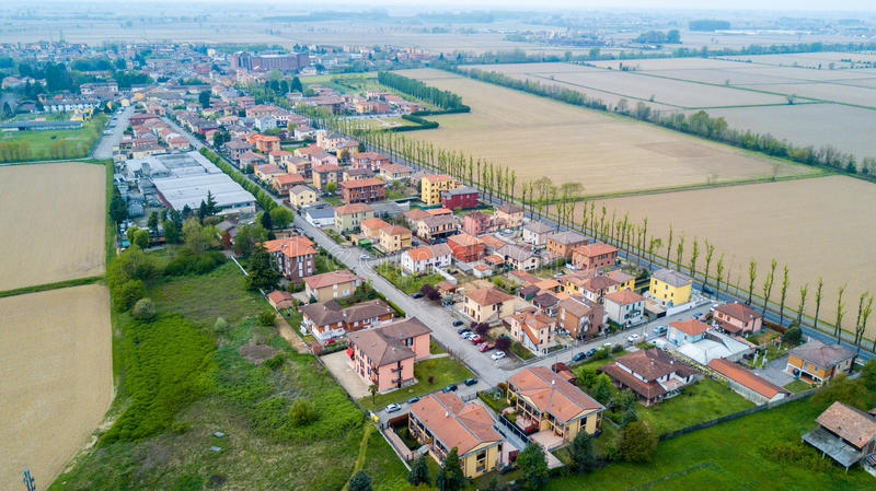 Certosa of Pavia, aerial view, village. Roofs and fields in the province of Pavia. Pavia, Lombardy, Italy. Certosa of Pavia, aerial view, village. Municipality stock photography