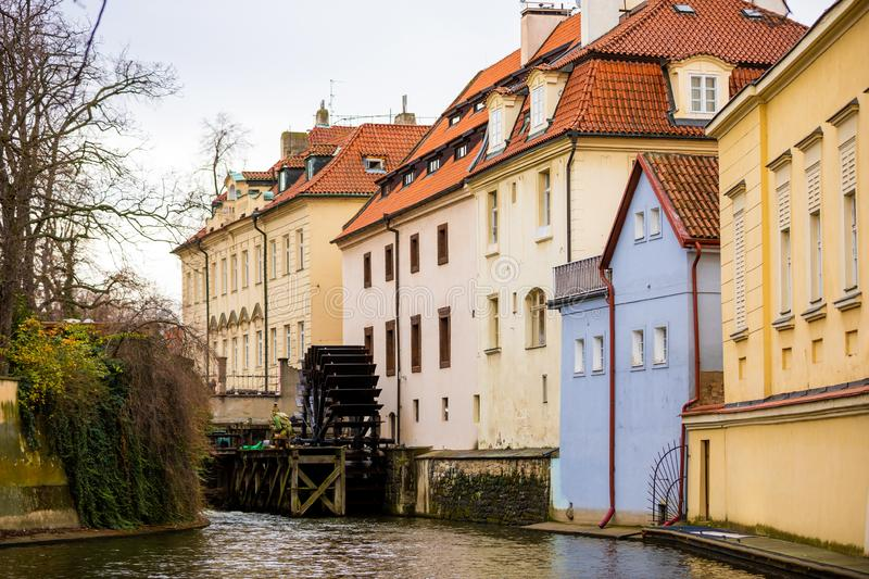 Certovka, Devil River, with watermill wheel at Kampa Island in Prague, Czech Republic royalty free stock photography