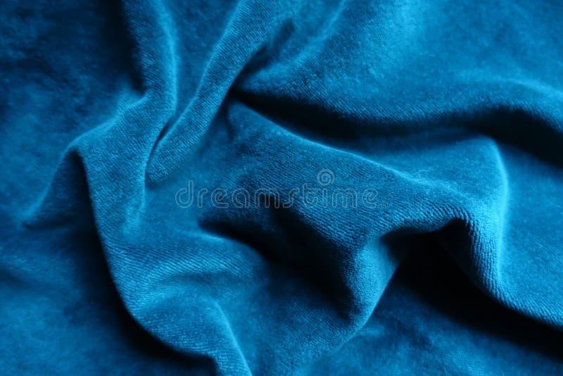 Cerulean dutte stof in zachte vouwen royalty-vrije stock afbeeldingen
