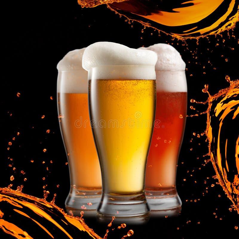 Cerveja diferente nos vidros imagens de stock royalty free