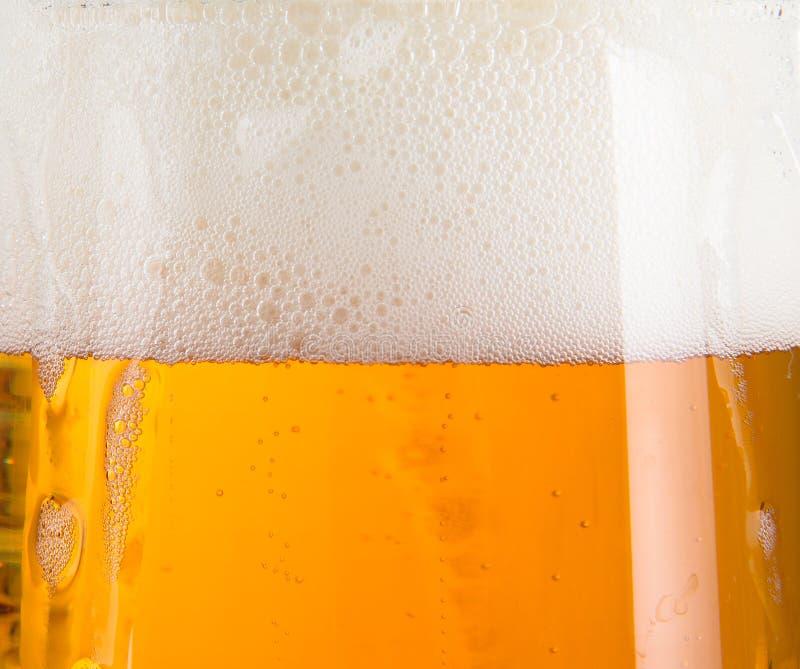 Cerveja em um vidro fotografia de stock royalty free