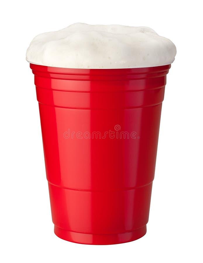 Cerveja no copo plástico fotografia de stock