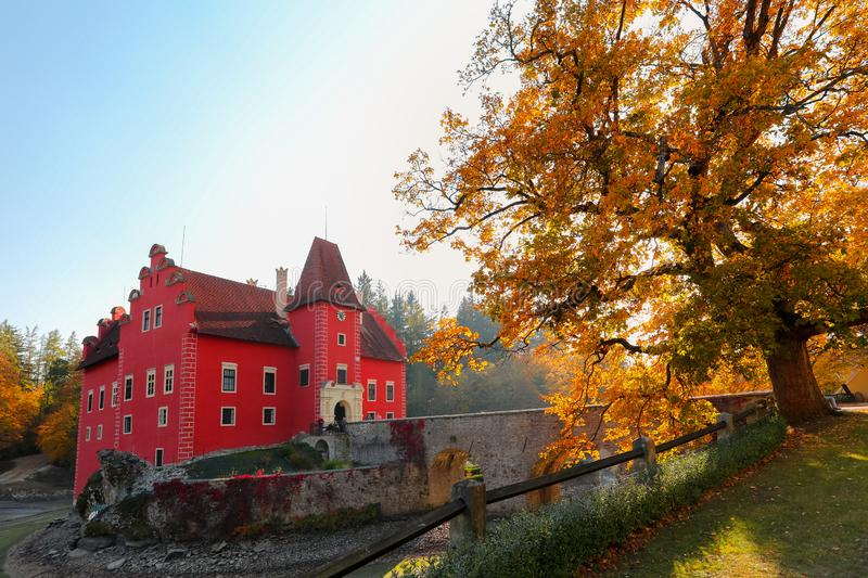 Cervena Lhota Castle in Czech Republic. Beautiful small red chateau Cervena Lhota, Castle in Czech Republic in autumn season with fall color and drained pond royalty free stock image