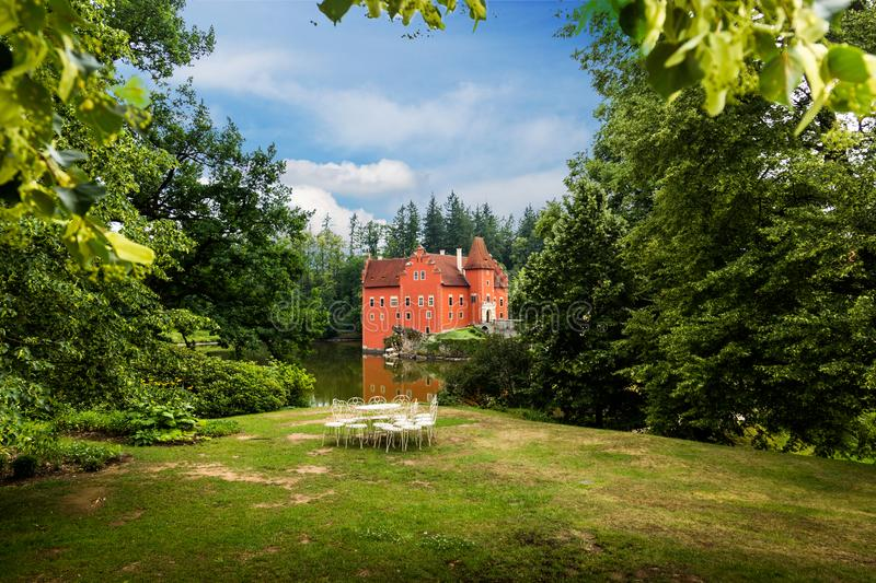 Cervena Lhota - the red, water chateau in the the Czech republic. stock photo