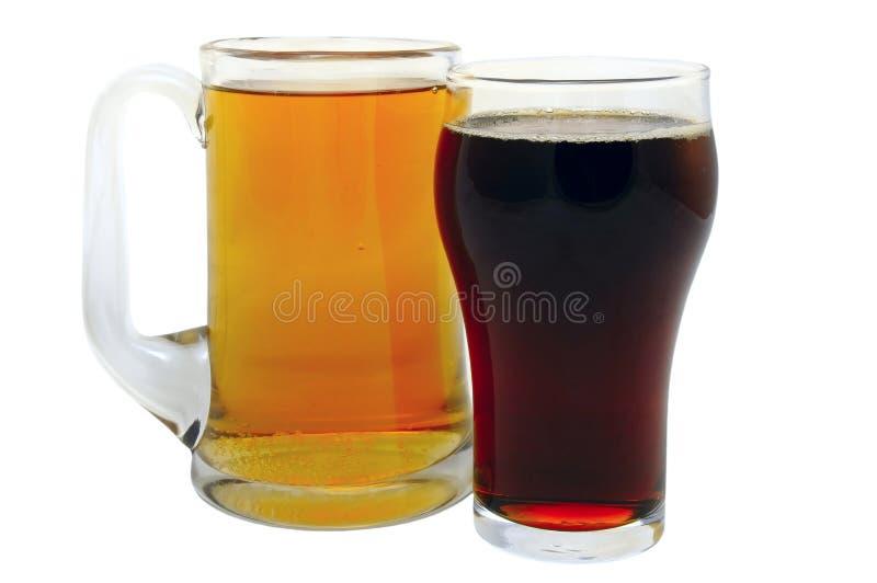 Cerveza dorada y cerveza oscura fotos de archivo libres de regalías