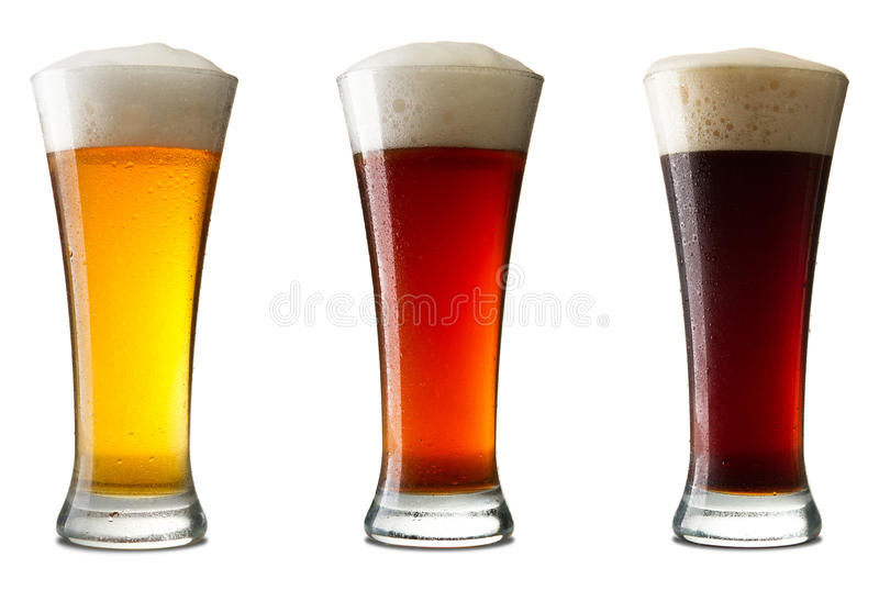 Cerveza fría tres, en blanco fotos de archivo