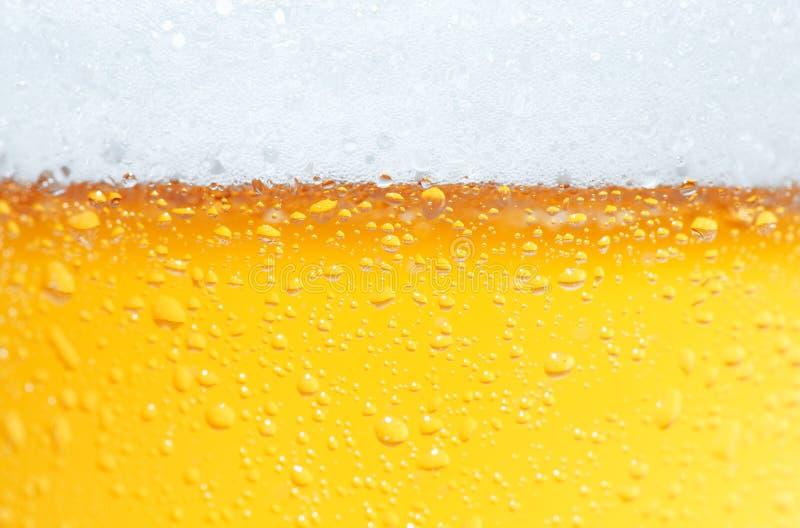 Cerveza una espuma. foto de archivo