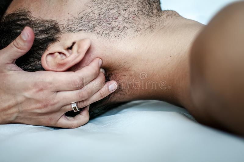 Cervical pain cured by physiotherapist royalty free stock image
