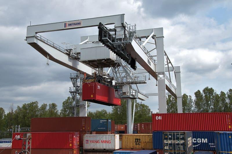 Ceska Trebova, Czech Republic - 20.4.2019: Container train terminal company METRANS. Cranes for loading containers. Railway. Junction and railway station Ceska royalty free stock photos