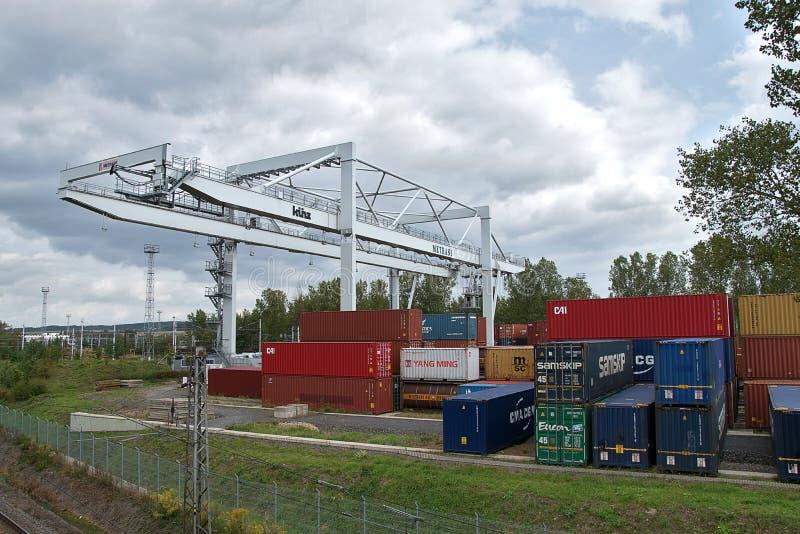 Ceska Trebova, Czech Republic - 20.4.2019: Container train terminal company METRANS. Cranes for loading containers. Railway. Junction and railway station Ceska stock image