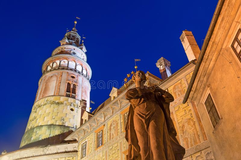 Cesky Krumlov castle and statue in South Bohemia, Czech Republic during blue hour sunset. UNESCO World heritage Site and famous pl. Ace for tourism royalty free stock photo