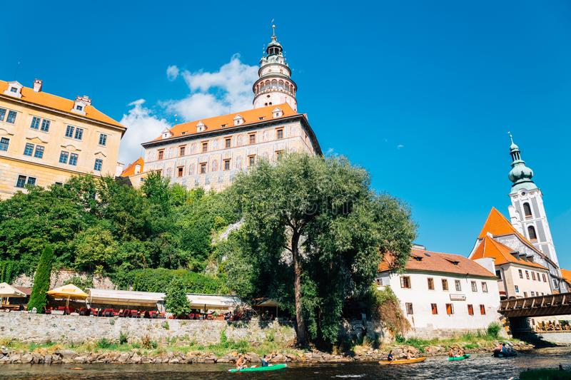 Castle Tower and Summer leisure kayaking at Vltava river in Cesky Krumlov, Czech royalty free stock photos