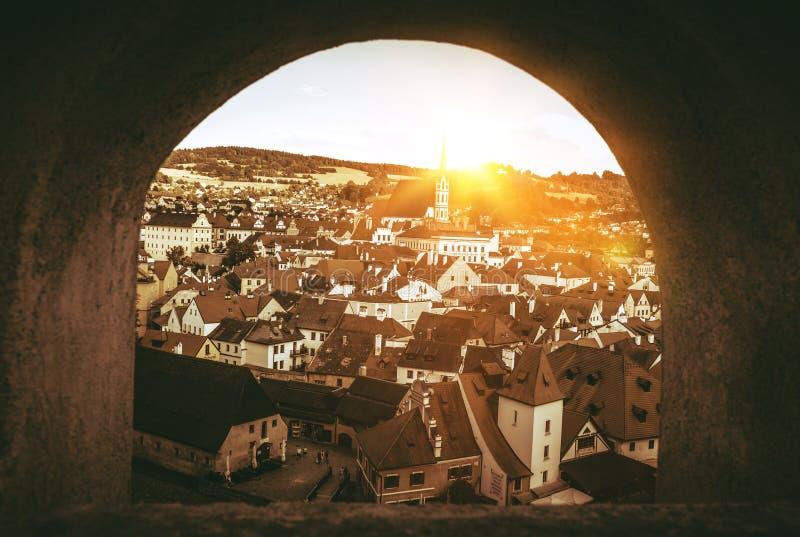 Cesky Krumlov Czechia. Cesky Krumlov Panorama Through The Castle Wall Window. Cesky Krumlov, Czechia, Europe. Sepia Color Grading royalty free stock photo