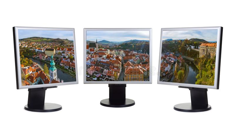 Cesky Krumlov panorama in Czech Republic my photo. On computer monitors - isolated on white background stock photography