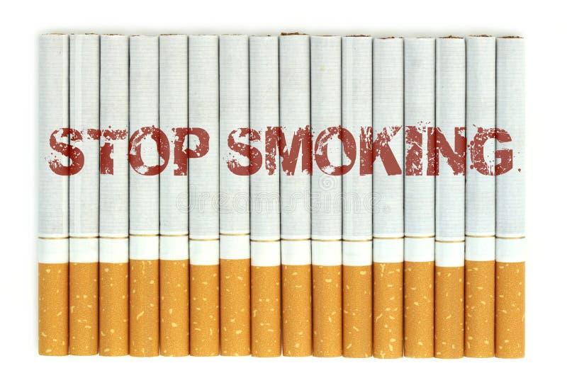 Cessez de fumer, des cigarettes d'isolement sur le fond blanc image libre de droits