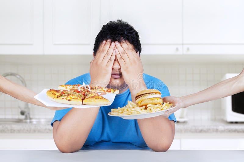 Cessez de manger de la nourriture industrielle photographie stock libre de droits
