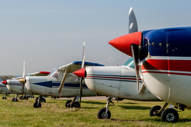 Cessna 152s Tied Down and Parked at Private Airfield. Against Blue Sky with Copy Space royalty free stock photo
