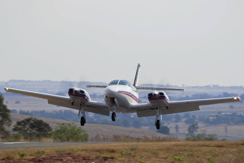 Cessna 303 Crusader Landing. The T303 is an all-metal low-wing six-seat piston-powered aircraft twin-engined aircraft with a tricycle undercarriage. Jack Taylor stock photo
