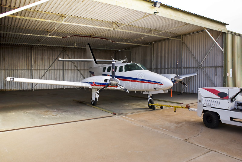 Cessna 303 Crusader Parked in Hangar. Overnight parking, storage, for this aircraft [Cessna T303] can be somewhat of a challenge. But with the aid of the Harlan royalty free stock images