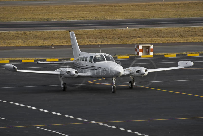 Cessna 402B Utiliner/Businessliner. The Cessna 402 a very dependable twin piston engined aircraft. [three bladed propeller] Its range and passenger capacity has stock photography