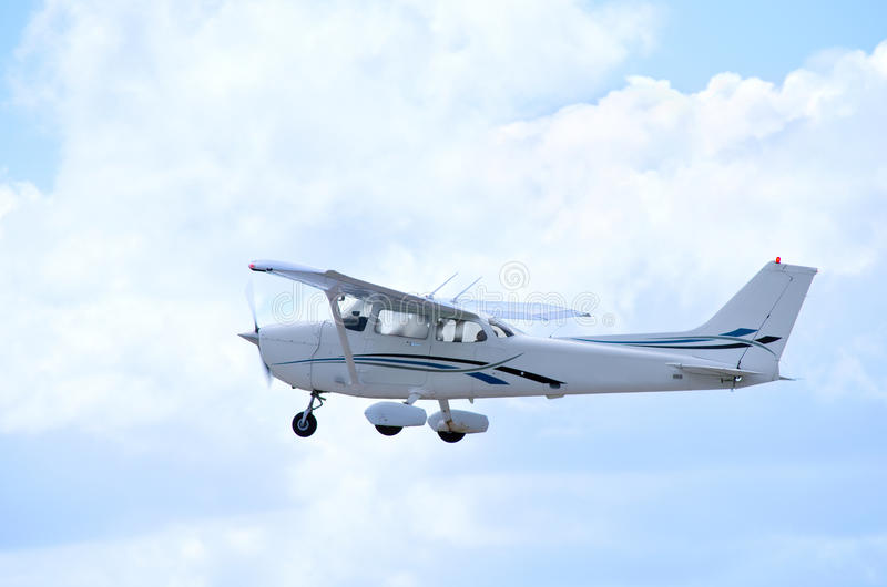 Cessna plane in flight. With dramatic clouds in the background stock image