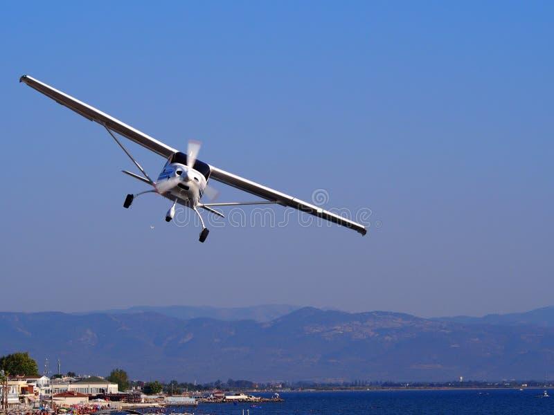 Cessna plane in flight stock photo