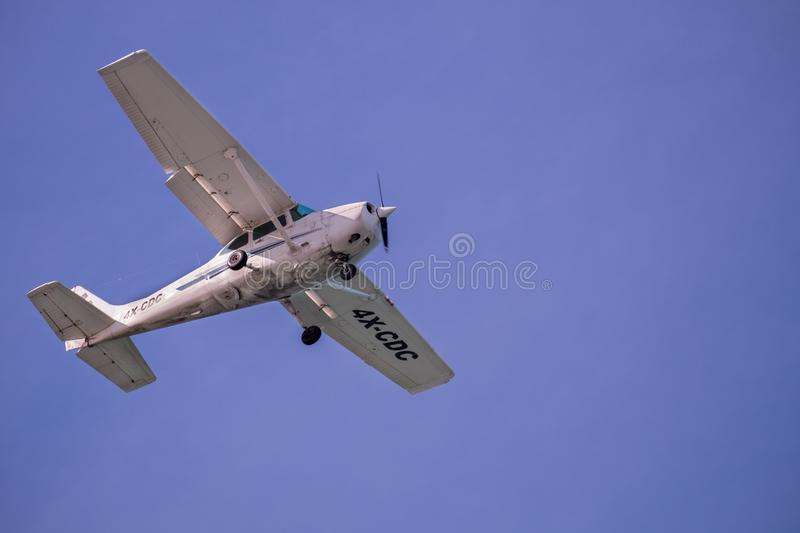 Cessna 172S (4X-CDC) flying on blue sky background. TEL-AVIV, ISRAEL - JANUARY 11, 2019: Cessna 172S (4X-CDC) flying on blue sky background stock photo