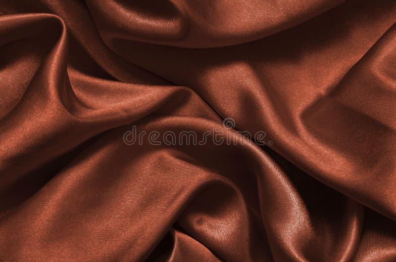 Cetim marrom da textura, fundo de seda fotografia de stock