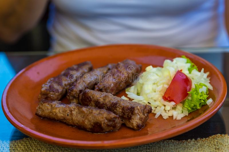 Cevapcici, a small skinless sausage, Zlatibor, Serbia. Cevapcici, a small skinless sausage cooked on the barbecue. Zlatibor, Serbia royalty free stock images