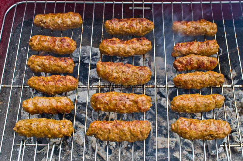 Cevapi on the BBQ. Delicious cevapi on the BBQ stock images