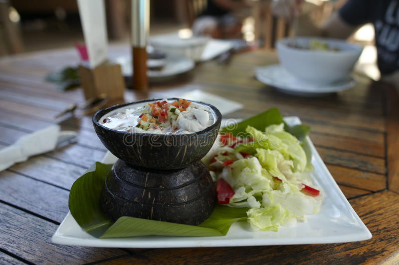 Ceviche with raw fish in coconut milk