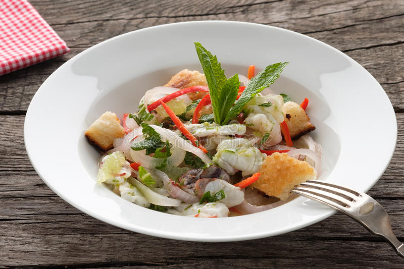 Ceviche with shrimps and lime in a plate royalty free stock photography