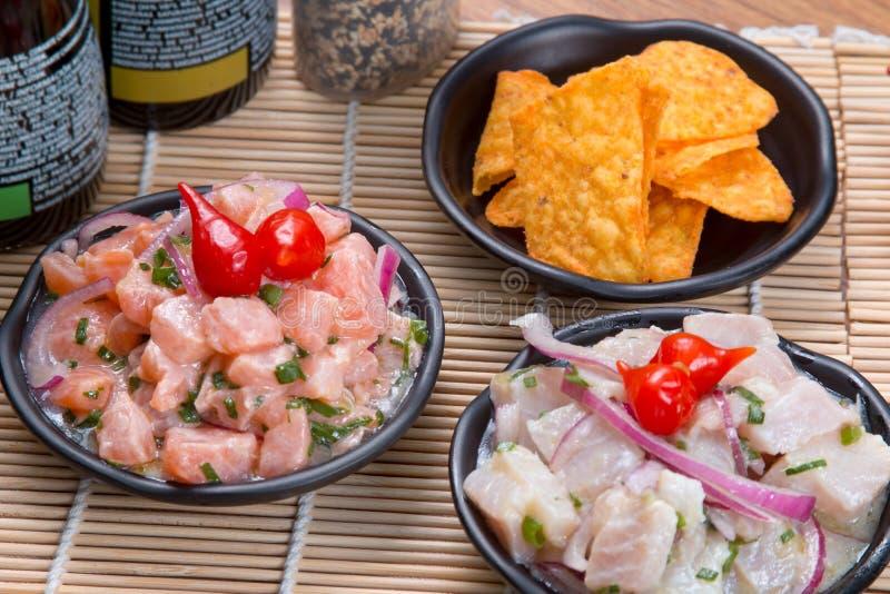 Ceviche tonfisk och lax royaltyfria foton