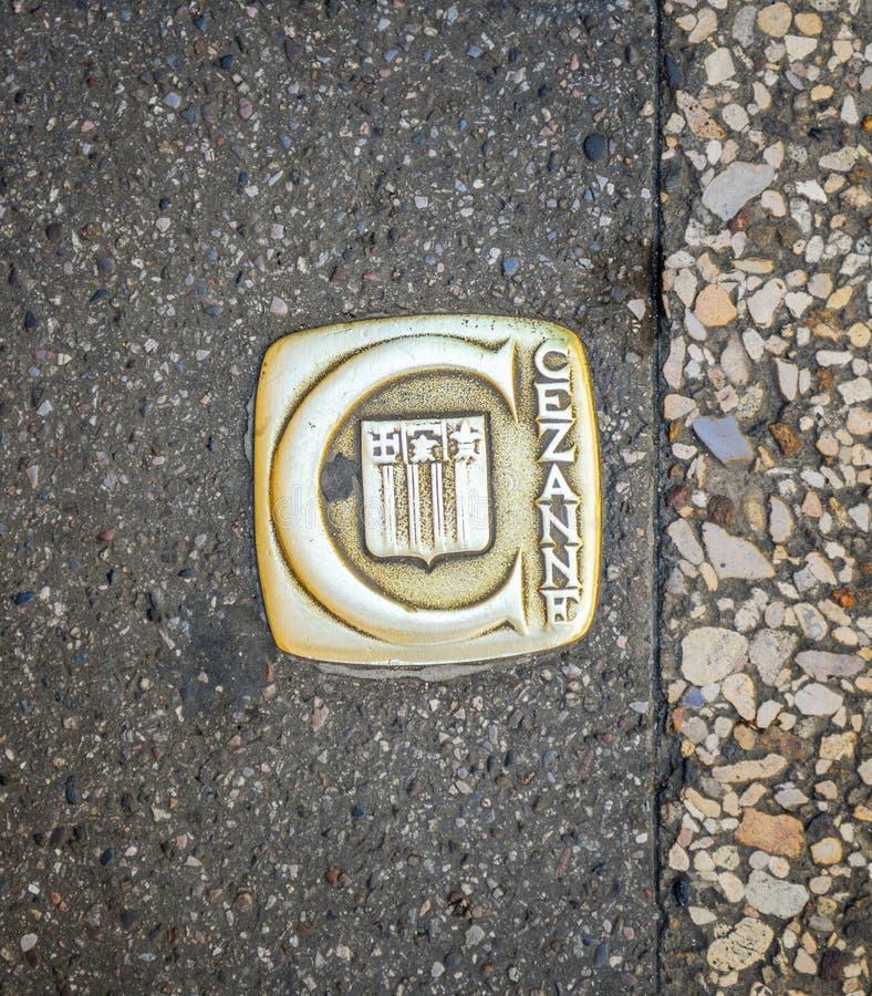 CEzanneinschrijving op het asfalt van Aix-en-Provence stock fotografie