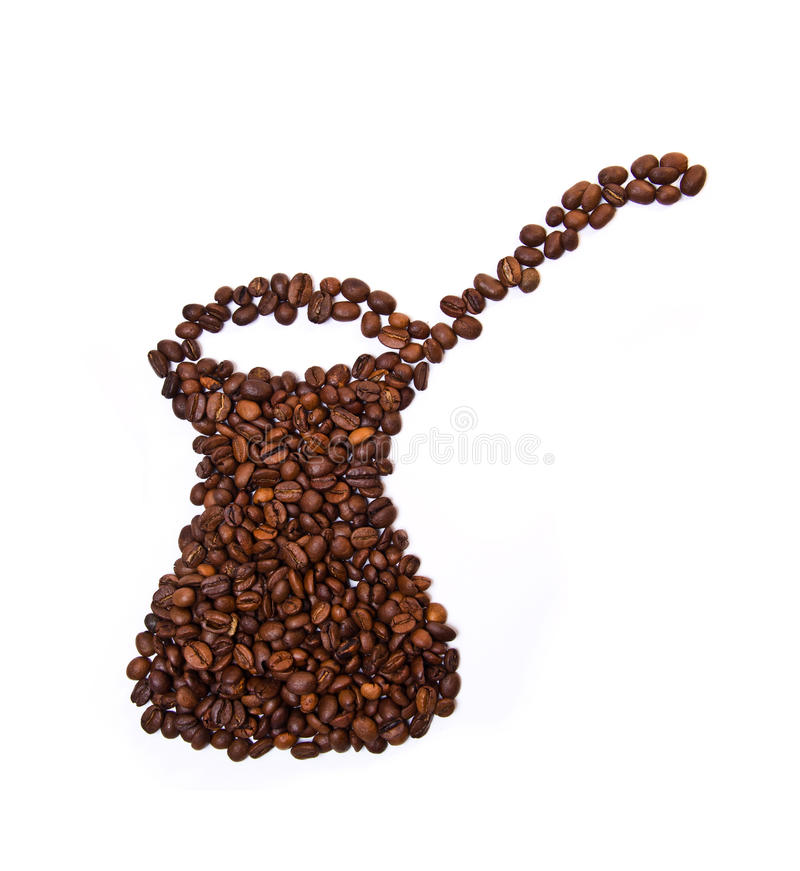 Cezve ha modellato i chicchi di caffè fotografia stock libera da diritti