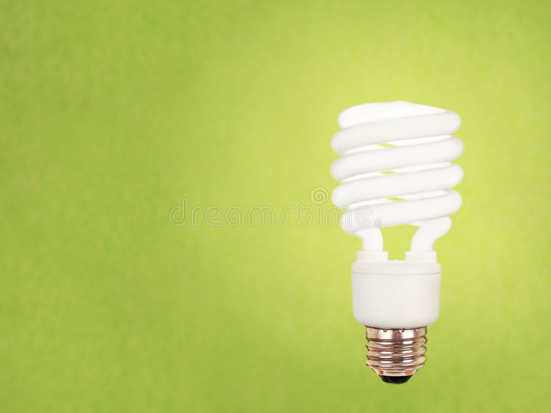 CFL Bulb On Green Royalty Free Stock Images